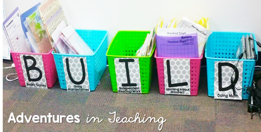"Colorful buckets filled with math activities and labels that spell out ""build""."