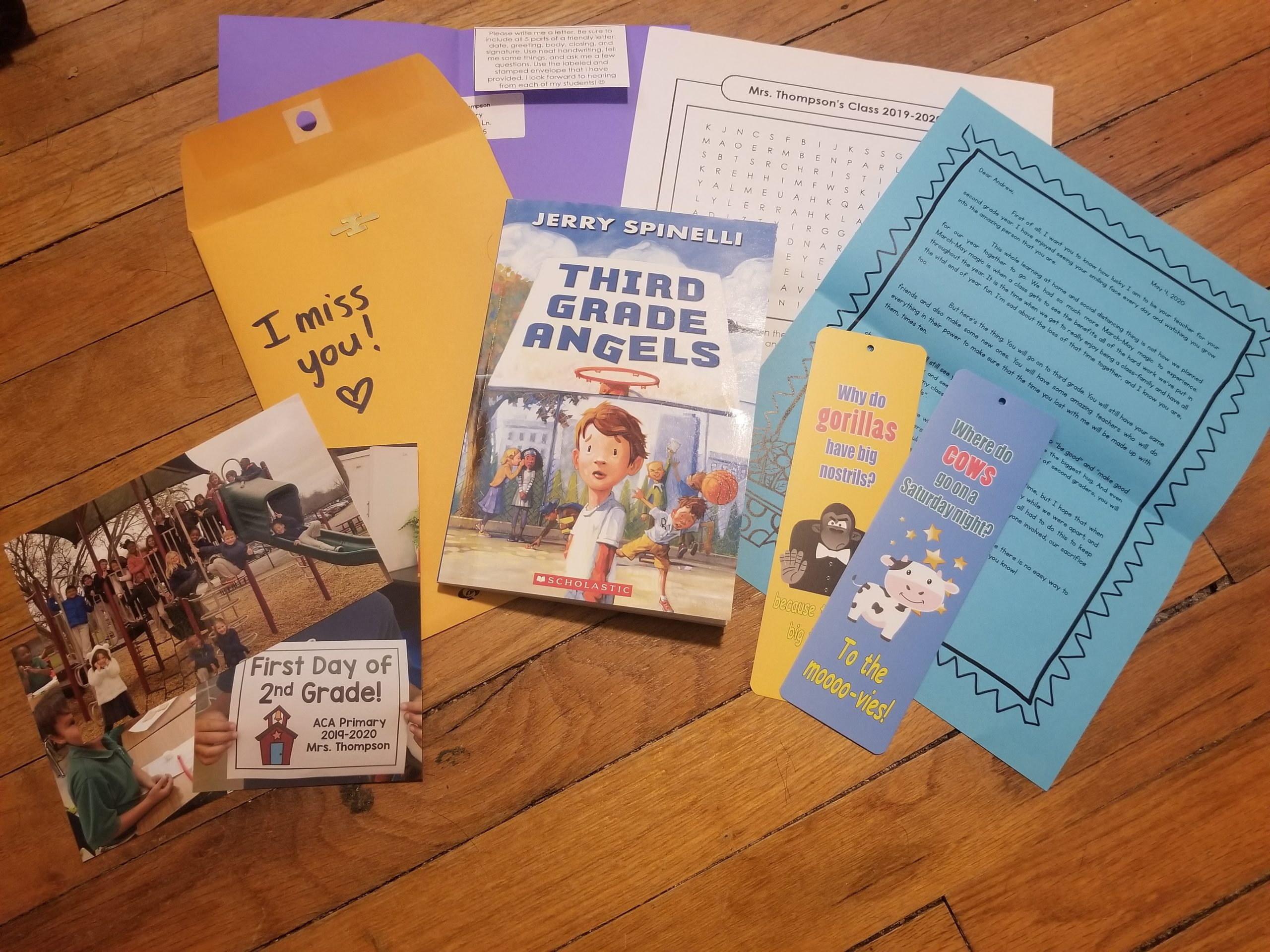 A care package with a book called Third Grade Angels, a book mark, a letter, a wordsearch, and pictures.