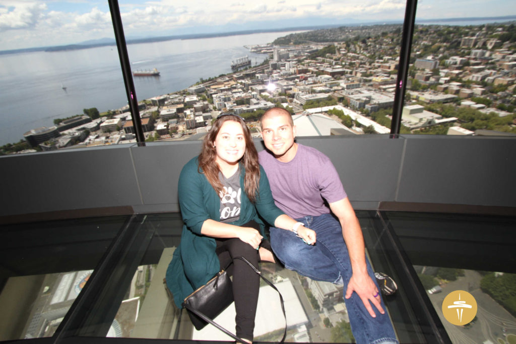 Cassie and her husband Jonathan are visiting the Space Needle in Seattle.