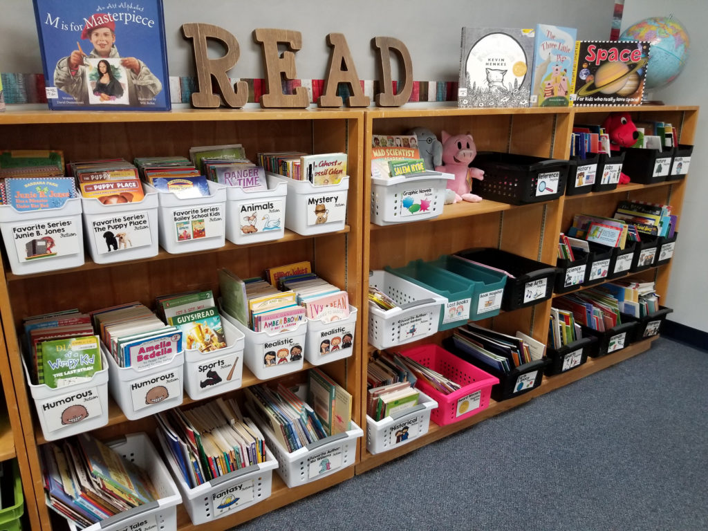 A classroom library organized and labeled by genre.